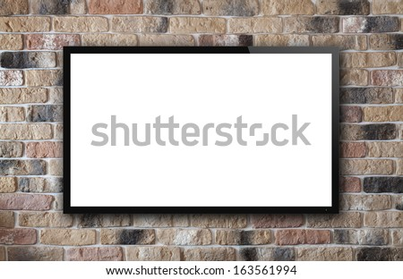 TV display on old brick wall background - stock photo