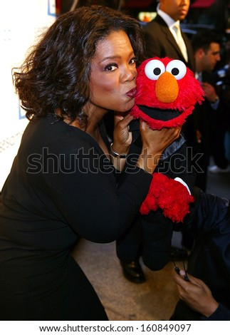 tv host oprah winfrey and friend elmo kiss at the sesame workshops second annual benefit gala - Oprah Winfrey Halloween Costume