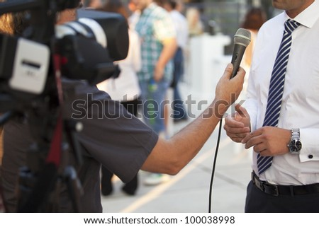 TV interview with a businessman - stock photo