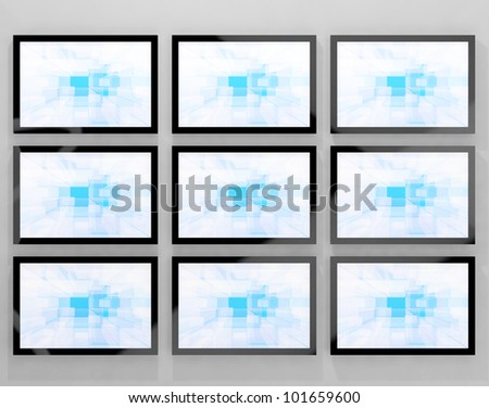 TV Monitors Wall Mounted Representing High Definition Television Or HDTVs - stock photo