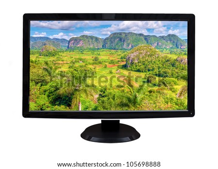 TV or computer monitor showing a tropical valley with mountains on the background  (isolated on white)