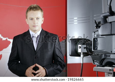 tv presenter in studio in front of the camera and viewers - stock photo