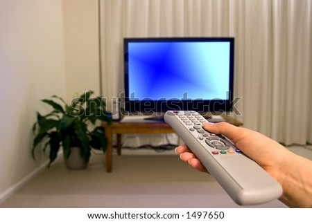 TV remote control and blurred background, shallow focus