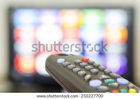 Tv remote control and tv set - stock photo