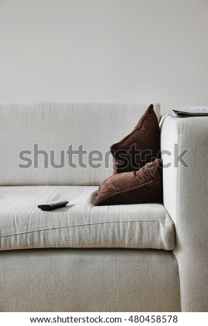 TV remote control on sofa in living room