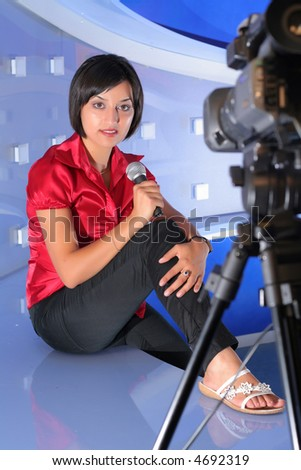 TV reporter with microphone taking an interview - stock photo