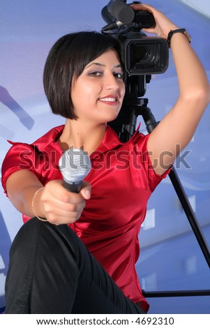 TV reporter with microphone taking an interview, stand-up - stock photo