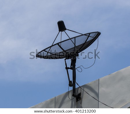 TV Satellite dish on the top of building.