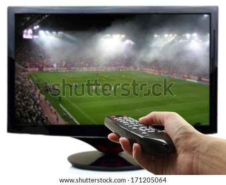 Tv screen with football match and hand with remote control - stock photo