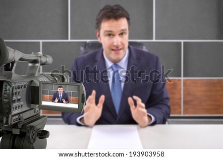 tv studio camera recording male reporter or anchorman - stock photo
