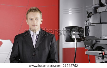 TV studio with video camera and presenter - stock photo