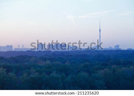TV tower and urban houses in early blue dawn in summer morning, Moscow - stock photo