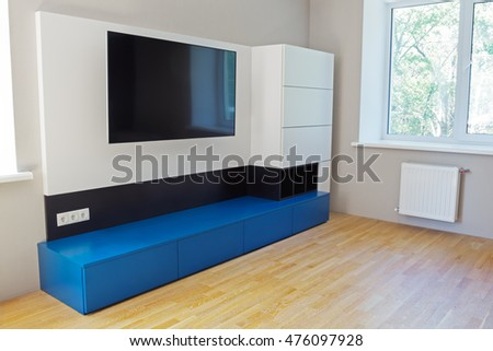 TV zone: furniture and attached television. Interior design