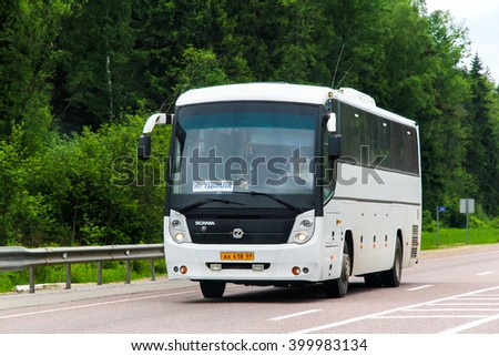 TVER REGION, RUSSIA - MAY 28, 2013: White intercity coach GolAZ 52911 Cruise at the interurban road. - stock photo