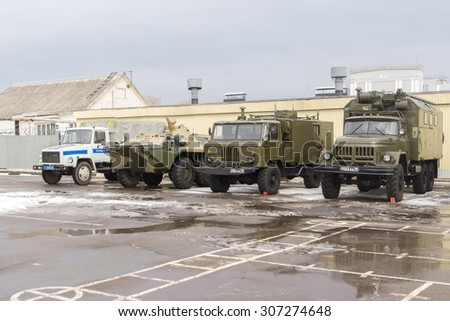 TVER, RUSSIA - MARCH 24, 2015: Military cars stand on the parade ground in a military unit in the open day