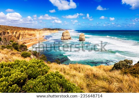 Twelve Apostles in bright turquoise sea along Great Ocean Road in Australia - stock photo