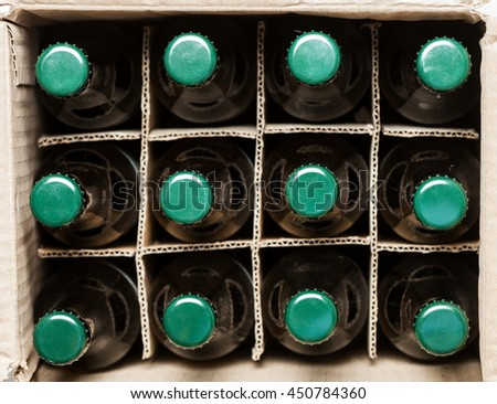 twelve beer bottles in cardboard box