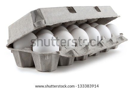 Twelve eggs in a carton package - stock photo