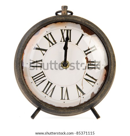 Twelve o'clock at a very old vintage watch - stock photo