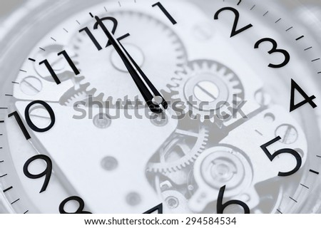 twelve oclock (midnight or midday) on clock, double exposure - stock photo