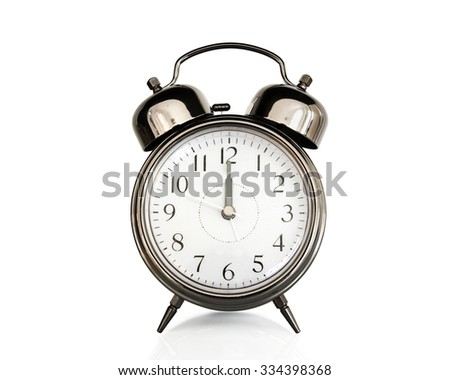 Twelve on an old vintage alarm clock isolated on white background