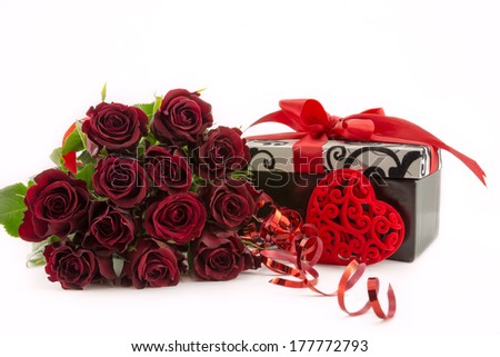 Twelve red roses,heart and gift.
