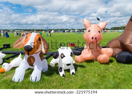 TWENTERAND, NETHERLANDS - JULY 6, 2014: Funny figures on the fifth international kite festival. Most of the participants are from Germany and Belgium. - stock photo