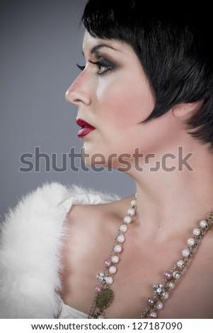 Twenties lady, brunette girl in 20-s style. - stock photo
