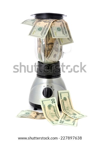 Twenty dollar bills placed in a blender on the white background. Isolated on white. - stock photo