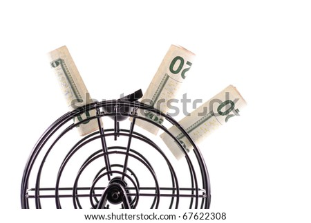 Twenty Dollar Bills Stuck on Lotto Cage - stock photo