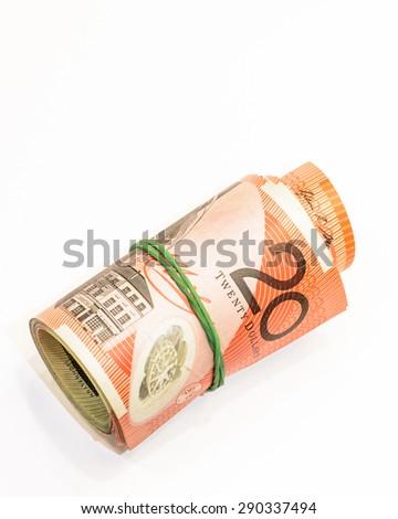 Twenty dollars Australian notes roll on white background - stock photo