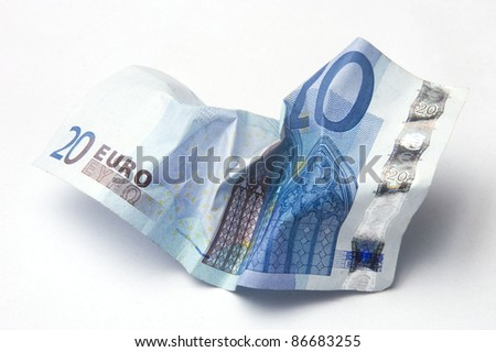 Twenty Euro bill crumpled on light background - stock photo