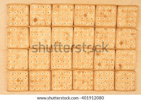 Twenty four cookies put on flat wooden surface for food background