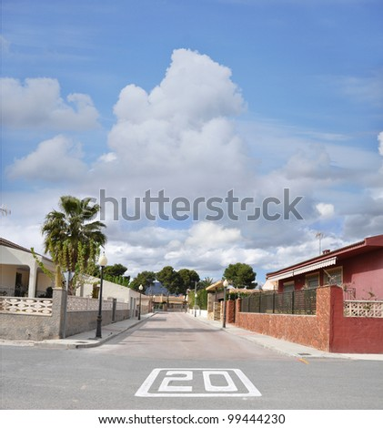 Twenty mile per hour traffic sign on street of Mediterranean suburban neighborhood in Spain Europe - stock photo