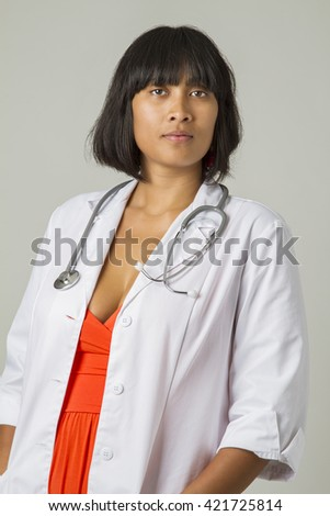 twenty something asian woman wearing a lab coat and a stethoscope - stock photo
