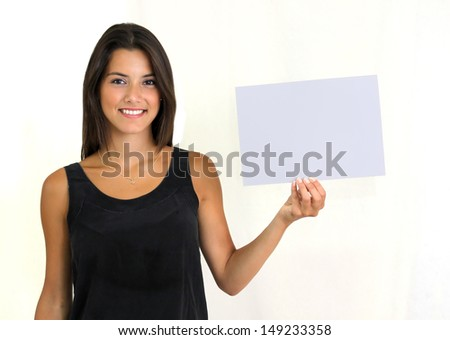 Twenty year old female brunette holding a grey card