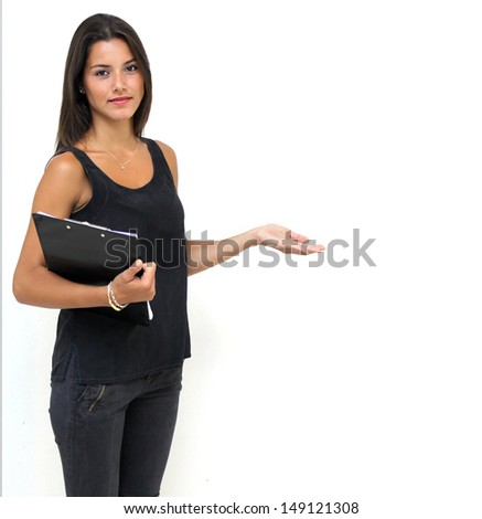 Twenty year old woman holding a clipboard with outstretched arm - stock photo
