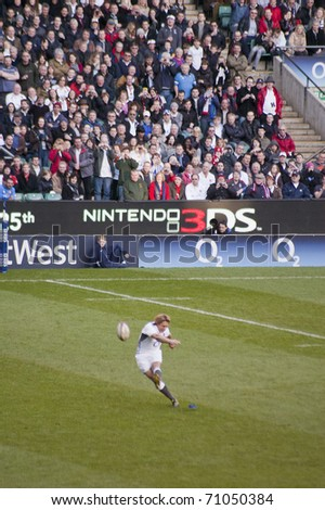 TWICKENHAM LONDON - FEB 12: Jonny Wilkinson kicking conversion goal at  England vs Italy, England playing in white Win 59-13, at RBS Six Nations Rugby Match on February 12, 2011 in Twickenham, England - stock photo
