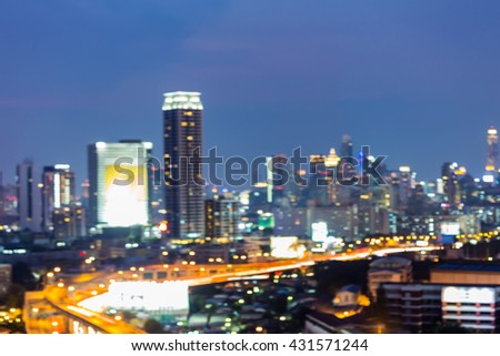 Twilight, abstract blurred bokeh lights, office building and highway night view