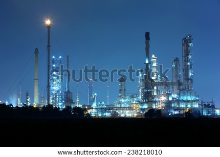 Twilight at petrochemical oil refinery factory  - stock photo