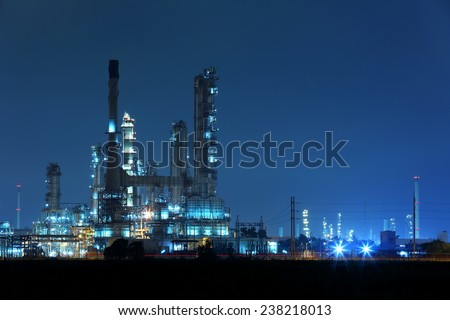 Twilight at petrochemical oil refinery factory