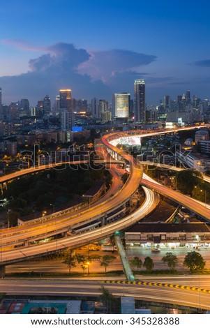 Twilight Bangkok elevated road interchange and junction overpass - stock photo