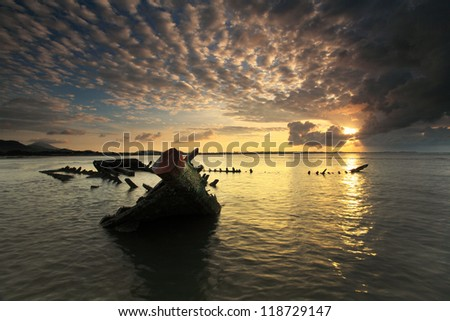 Twilight coast scene with the ship wreck ,southern of Thailand
