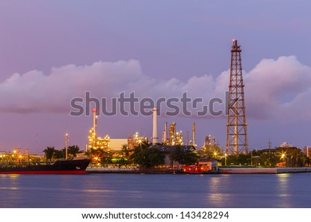 twilight derrick  petroleum with boat shipping - stock photo