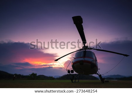 Twilight helicopter on the helipad. - stock photo