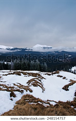 Twilight in the winter mountains, Ukrainian Carpathians , view the Montenegrin Mountains
