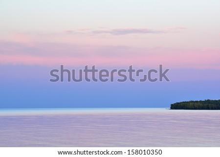 Twilight Lake Superior at Porcupine Mountains Wilderness State Park, Michigan's Upper Peninsula, USA - stock photo