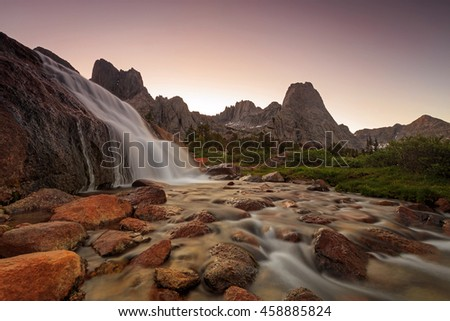 Twilight landscape with a waterfall in the Wind River Mountains, Wyoming, USA. - stock photo