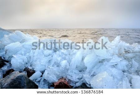 Twilight misty rubble ice Baltic seashore landscape   - stock photo