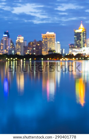 Twilight of city light bokeh during twilight with water reflection - stock photo